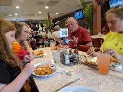 Bud and Lou Ann Newell, Savannah Connor and Rhea Profit after digging dinner Friday in downtown Thomson, Georgia.