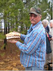 Gene Blackerby shows off a nice sample of Clio fossillized wood.