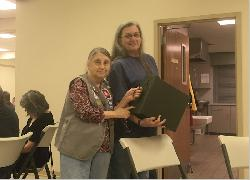 End of an era - Sandra Sullivan handing over the History Box to Donna Sellers at the October 12, 2018, meeting.